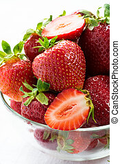Strawberries in glass bowl on white background