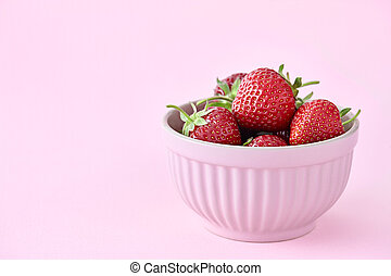 Strawberries in pink bowl