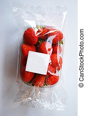 Strawberries in plastic box with free white label