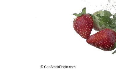 Strawberries in water isolated on white