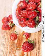 strawberries in white plate