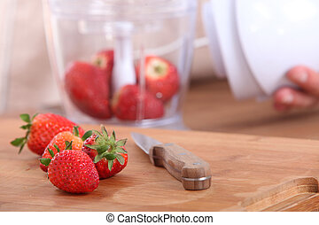 strawberries on a cutting board