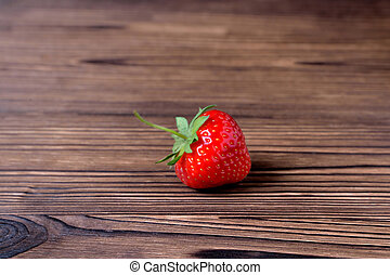 Strawberries on a natural wooden background close-up