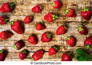 Strawberries on rustic wooden background