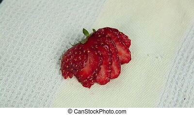 Strawberries On To Tart - Sliced strawberries being put on a...
