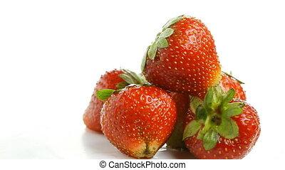 strawberries on white, rotating