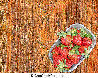 Strawberries On Wooden Background