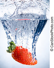 strawberries - one red beauty big strawberry drop in blue...