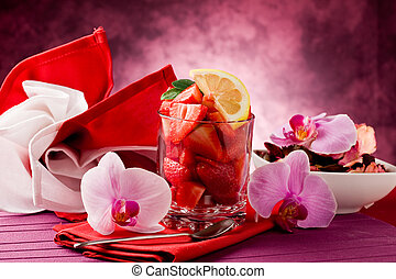 Strawberries with Orchid on red tab - photo of delicious cut...