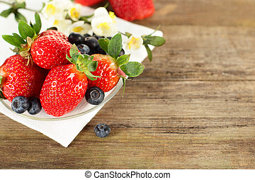 Strawberry and blueberry on background - healthy food