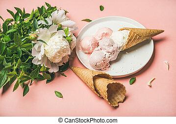 Strawberry and coconut ice cream, cones, white peony flowers