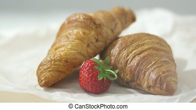 Strawberry and croissants - Close-up shot of baked croissant...
