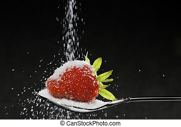 strawberry and sugar - red strawberry with sugar on spoon
