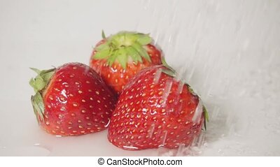 Strawberry and water splash, slow motion