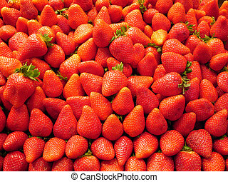 Strawberry background - fruit and vegetables on a market -...
