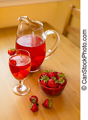 strawberry beverage - chilled strawberry drink with bowl of...