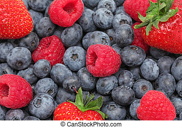 Strawberry, blueberry and raspberry. Background