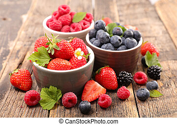 strawberry, blueberry and raspberry on wood background