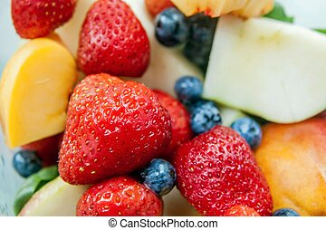 Strawberry blueberry peach apple fruit mix