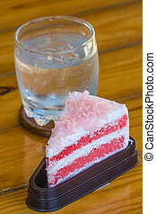 Strawberry cake on wood table