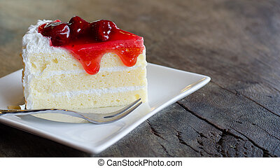 strawberry cake on wooden table