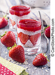 Strawberry chia pudding with oat flakes