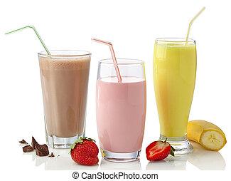 Strawberry, chocolate and banana milkshakes isolated on...