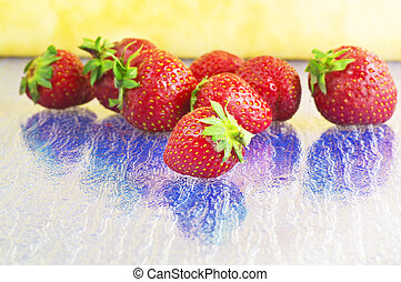 Strawberry close up on the blue table