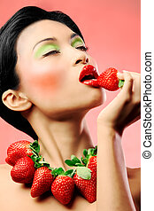 Strawberry delight - Creative makeup beauty shot of model...