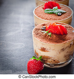 Strawberry dessert tiramisu in a glass whith mint