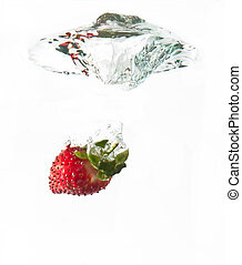Strawberry dropped into water splash