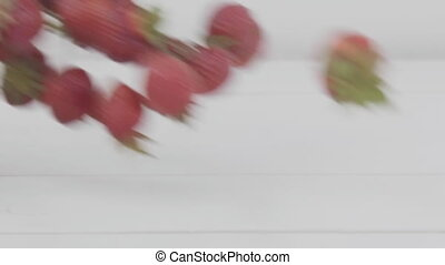 strawberry falls on the table - strawberry drops on the...