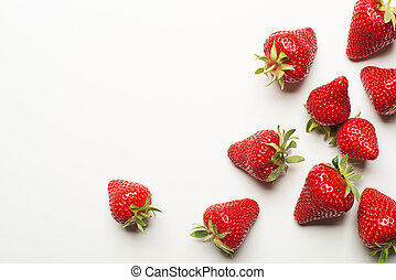 Fresh red strawberry on a white background close up.
