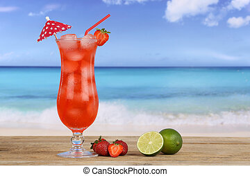 Strawberry fruit cocktail on the beach