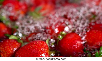 Strawberry fruit infused water. Close up of crop horizontal...