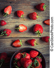 strawberry fruit on grunge wooden background