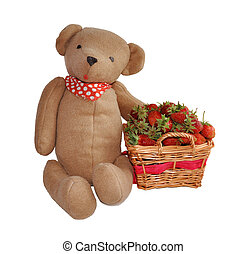 Strawberry in a basket and hand made teddy bear toy isolated on