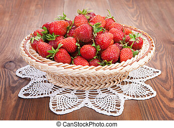 Strawberry in a basket on the table