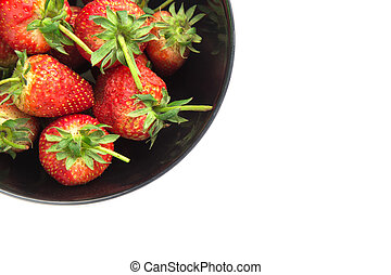 Strawberry in a bowl isolated on white background