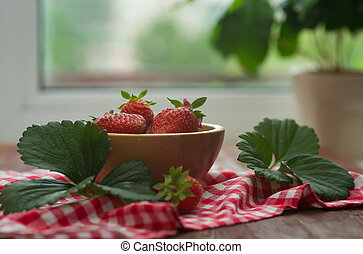 strawberry in a wooden bow