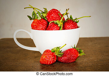 Strawberry in cup on white 2