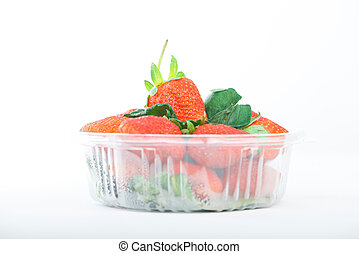 Strawberry in plastic box on white