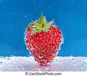 Strawberry in soda water - Strawberry with bubbles in soda...