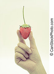 Strawberry in woman hand isolated on white background