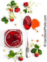 Strawberry jam and fresh berries on white background