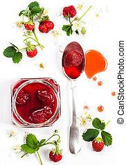 Strawberry jam and fresh berries on white background