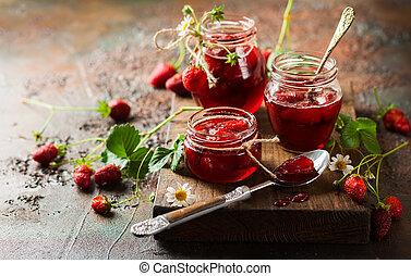 Strawberry jam - Homemade strawberry jam in glass jars on...