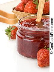 strawberry jam isolated on white background