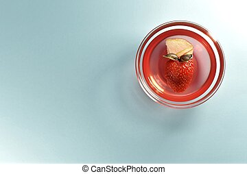 Strawberry jelly with fresh berries in a cup.