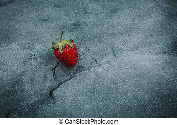 strawberry lies on a gray background